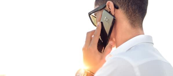 Adult Holding Samsung Galaxy S9